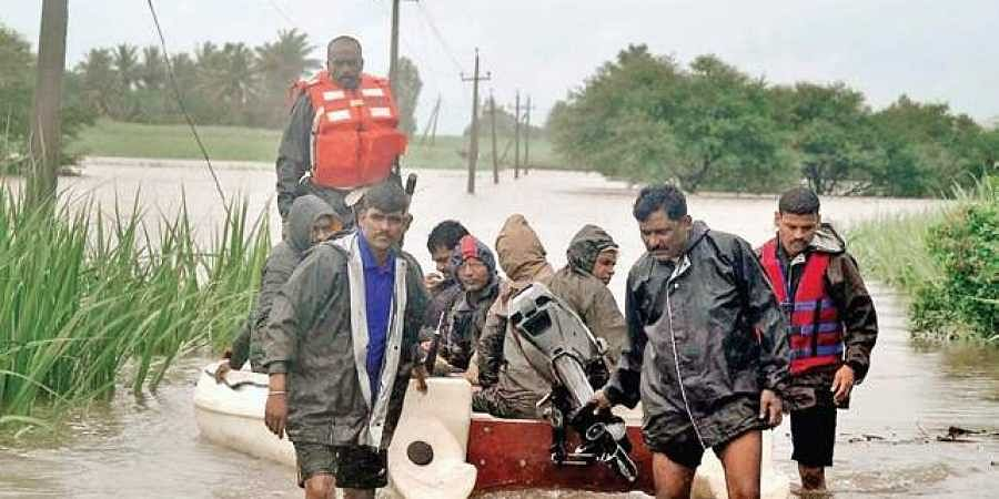 State Disaster Relief Force personnel rescue flood-affected people at Manjiri village of Chikkodi taluk in Belagavi district on Sunday