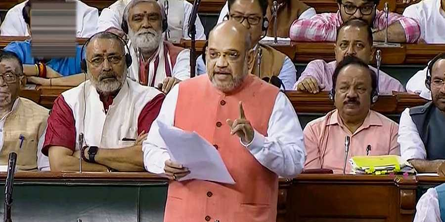 Union Home Minister Amit Shah speaks during the resolution on Kashmir in the Lok Sabha in New Delhi.