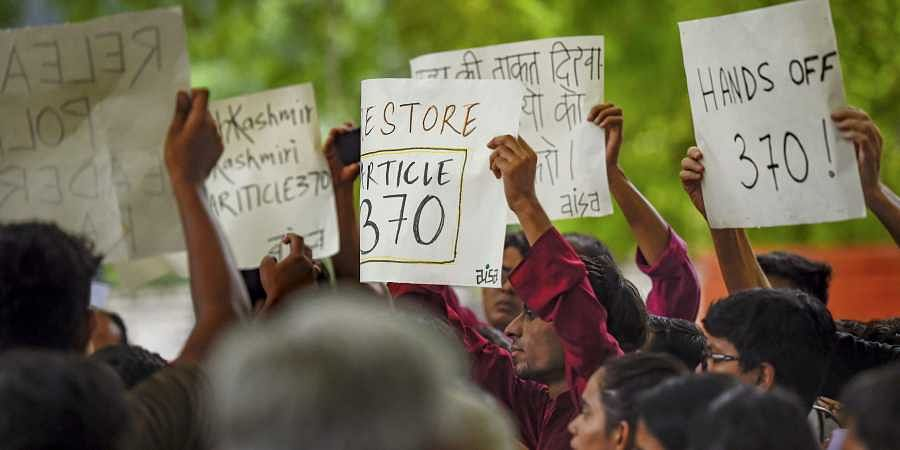 Activists of AISA, CPI-M and other organisations display placards during a protest against the union government's move to revoke Article 370 in Jammu Kashmir in New Delhi on 5 August 2019. (Photo | PTI)