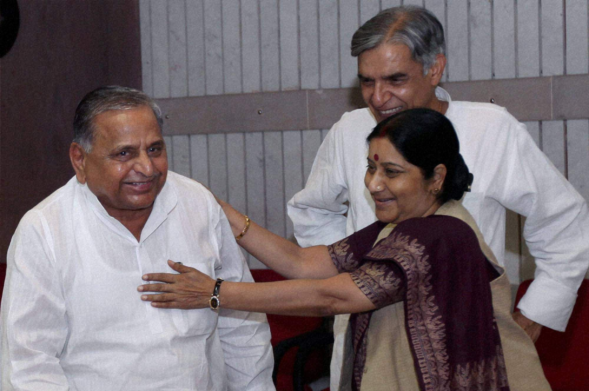 Leader of Opposition in the Lok Sabha, Sushma Swaraj with Samajwadi Party chief Mulayam Singh Yadav (L) at an all party meeting called by Lok Sabha Speaker ahead of the monsoon session of parliament 2010 at Parliament House in New Delhi.