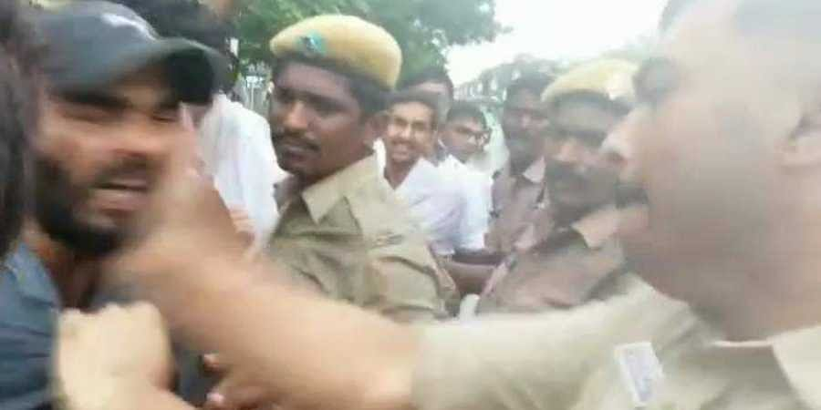 Vijayawada Deputy Commissioner of Police V Harshavardhan Raju during a scuffle with the protesting junior doctors.