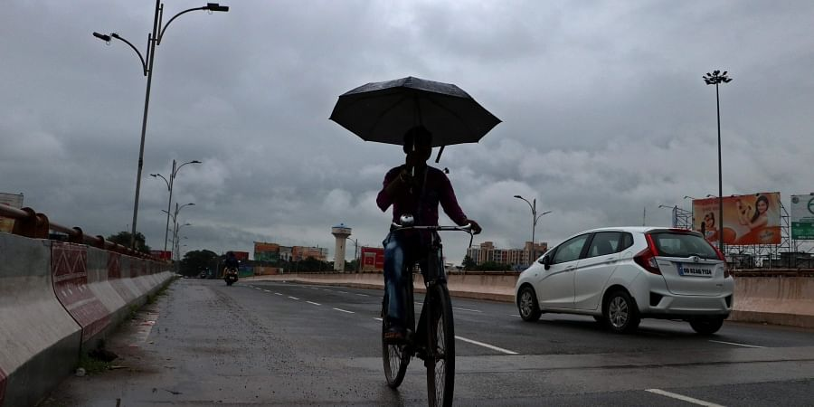 Commuters prepared to face rains.
