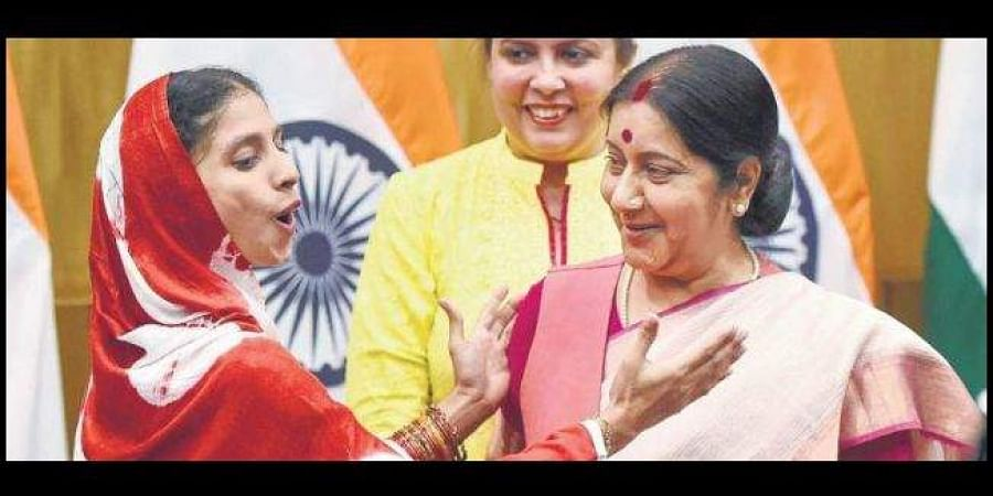 Swaraj, seen here with Geeta, had said the government would take care of her.