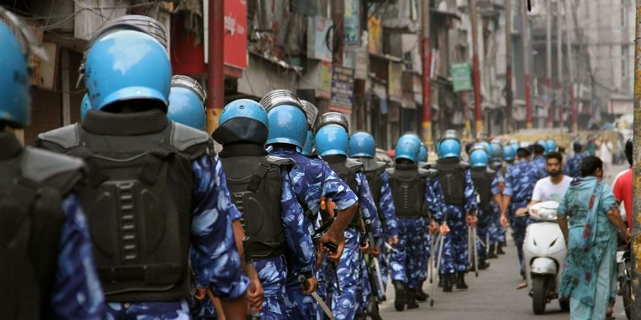 Rapid Action Force RAF personnel patrol a street during restrictions in Jammu.
