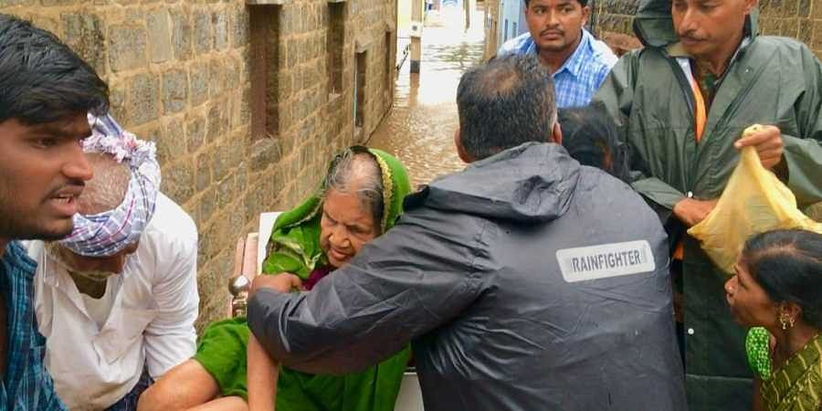 97-year-old Chandrava Solabavi was rescued in the floodsin floods in Malali village near Mudhol in Karnataka on 8 August 2019. (Photo | EPS)