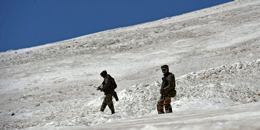 Army soldiers patrol in the snow bound way to frontier region of Ladakh.