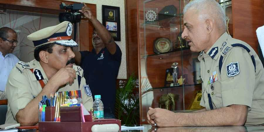 New Odisha DGP Bijay Kumar Sharma with outgoing Police chief Dr RP Sharma at State Police headquarters in Cuttack on Thursday