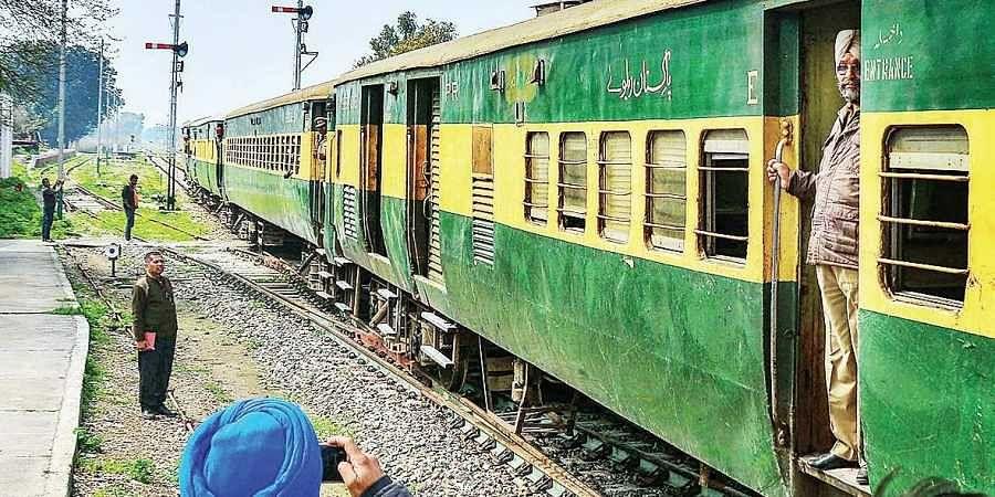 Passengers arrive by the Samjhauta Express in Attari