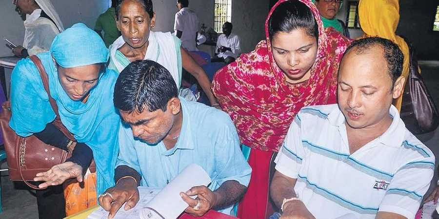 People check the final list for their names Saturday at an NRC centre in Morigaon, Assam.