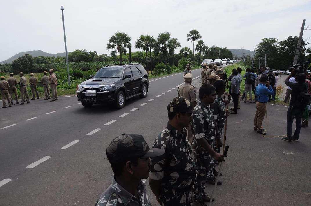AP CM YS Jagan Mohan Reddy's convoy passes through Large number of policemen which were deployed  to stop TDP national president Chandrababu Naidu to take part in Chalo Atmakuuru program at Tadepalli near Vijayawada on Wednesday. (Photo | EPS/Prasant Madugula)