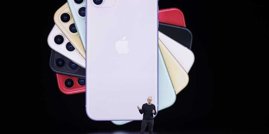 Apple CEO Tim Cook talks about the latest iPhone during an event to announce new products Tuesday, Sept. 10, 2019, in Cupertino, Calif.   AP
