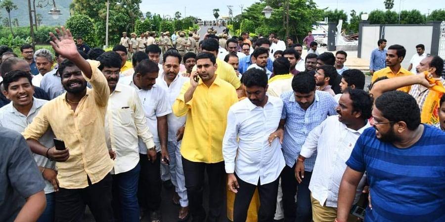 Police stopping TDP general secretary Nara Lokesh during Chalo Atmakur programme at his residence in Undavalli near Vijayawada.