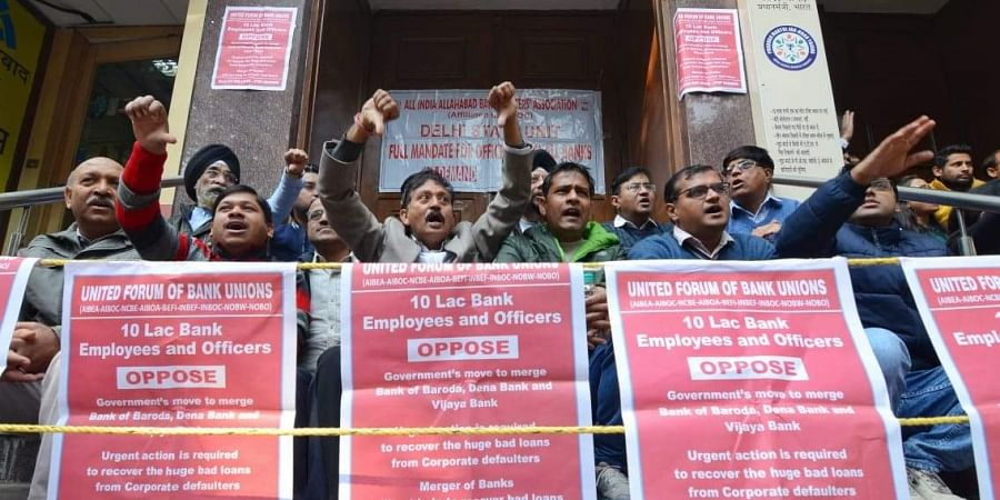 Members of United Forum of Bank Unions stage a protest outside Allahabad bank in New Delhi.