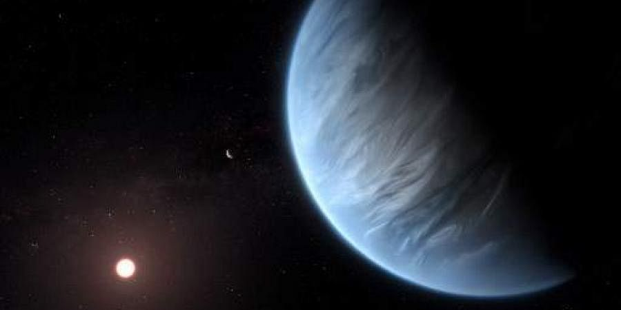 A handout artist's impression released on September 11, 2019, by ESA/Hubble shows the K2-18b super-Earth, the only super-Earth exoplanet known to host both water and temperatures that could support life. | AFP