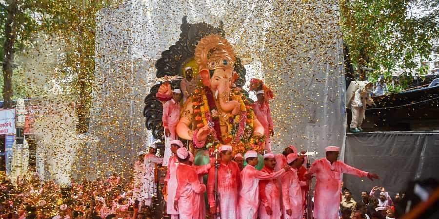 Devotees carry the Ganesha idol of Lalbaugcha Raja for immersion which marks the end of Ganesh Utsav celebrations in Mumbai