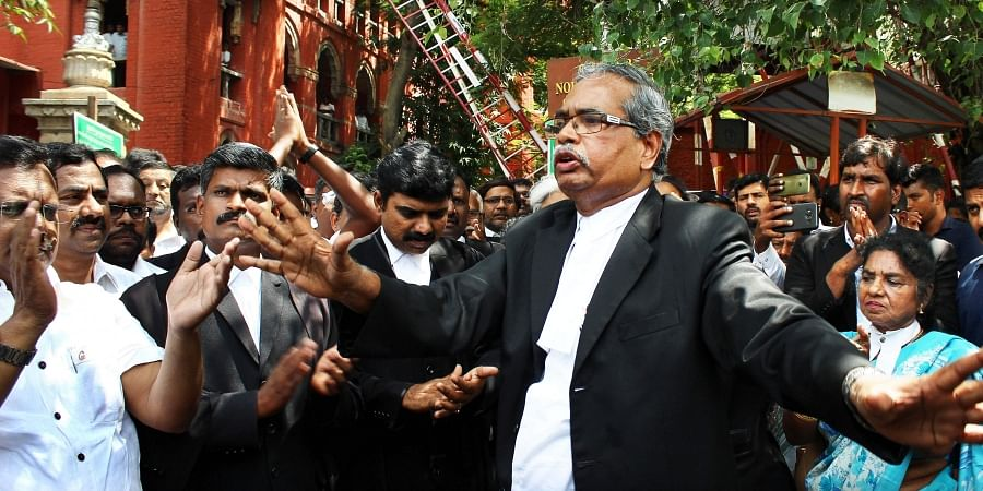 Lawyers staging a protest in the Madras High Court campus