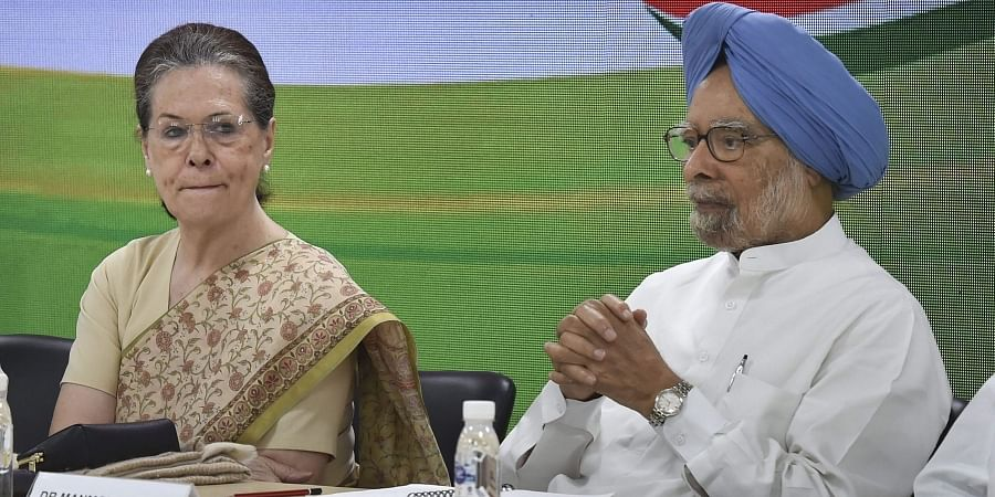 Congress interim president Sonia Gandhi with former PM Manmohan Singh at a party meeting to discuss plans for the 150th birth anniversary of Mahatma Gandhi at AICC HQ in New Delhi.