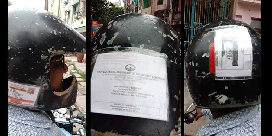 Stills from the viral video shows Ram Shaw's helmet decorated with all papers.