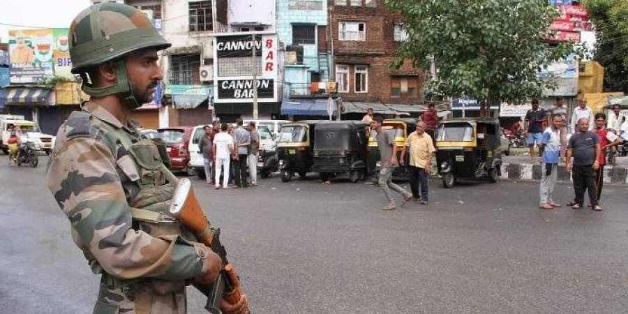 Army personnel stand guard during restrictions in Jammu.