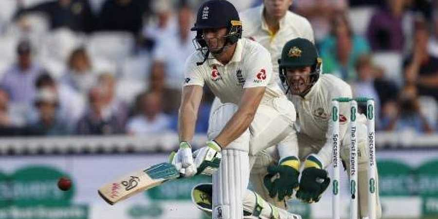 England's Jos Buttler bats during play on the first day of the fifth Ashes cricket Test match between England and Australia at The Oval in London on September 12, 2019. | AFP