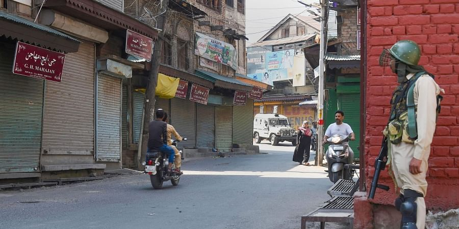 A security personnel stands guard during restrictions in Downtown Srinagar Friday September 13 2019. | PTI