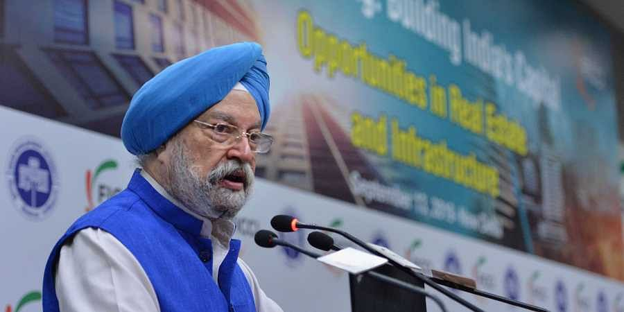 Union Minister for Housing and Urban Affairs Hardeep Singh Puri addresses during the inaugural conference of Land Pooling Building India's Capital at FICCI in New Delhi