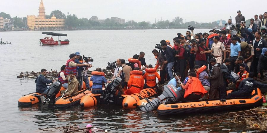 Bhopal State Disaster Emergency Response Force SDERF personnel during a search and rescue operation after a boat capsized in the Lower Lake.