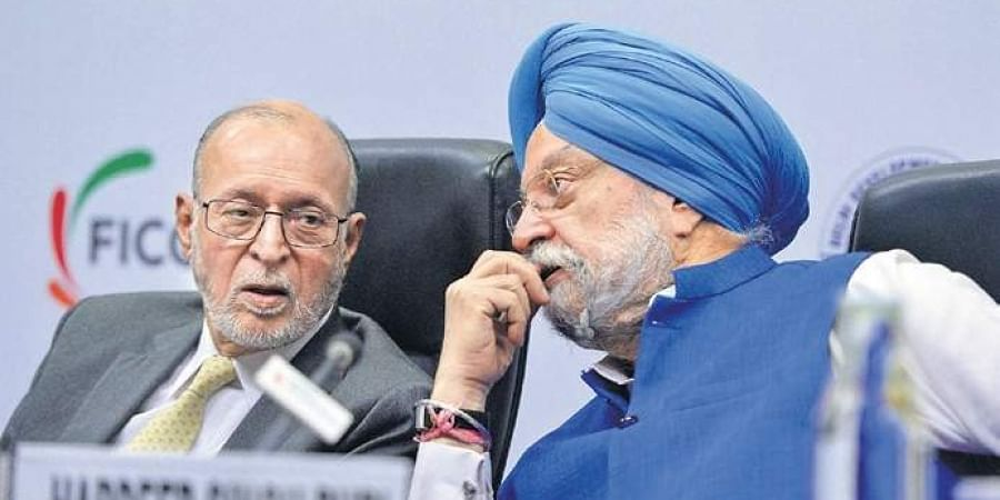 Union Minister for Urban Affairs Hardeep Singh Puri with Delhi L-G Anil Baijal during 'Land Pooling: Building India's Capital' conference in New Delhi.
