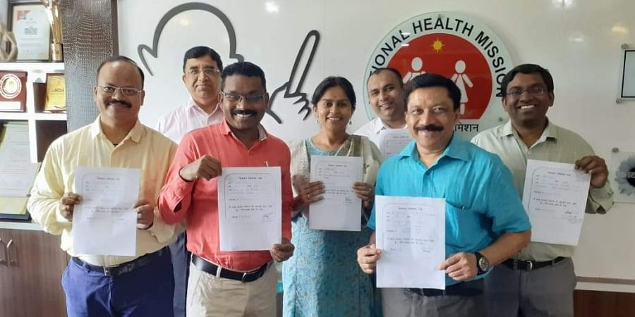 Civil servants in Chhattisgarh holding a pledge form they had signed for eye donation