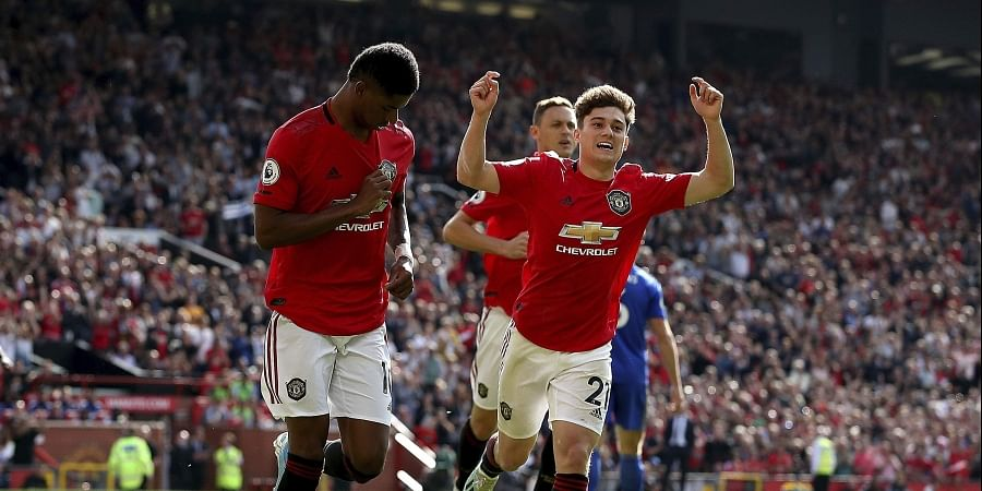 Manchester United's Marcus Rashford, left, celebrates scoring his side's first goal of the game from the penalty spot during the English Premier League soccer match between Manchester United and Leicester City at Old Trafford Stadium, Manchester England.