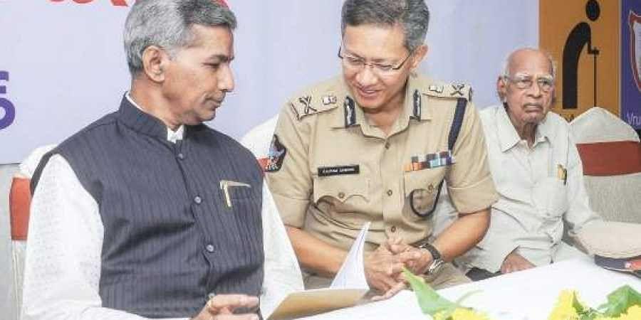 Former Telangana High Court judge Justice B Siva Sankara Rao with Vijayawada police commissioner Gautam Sawang
