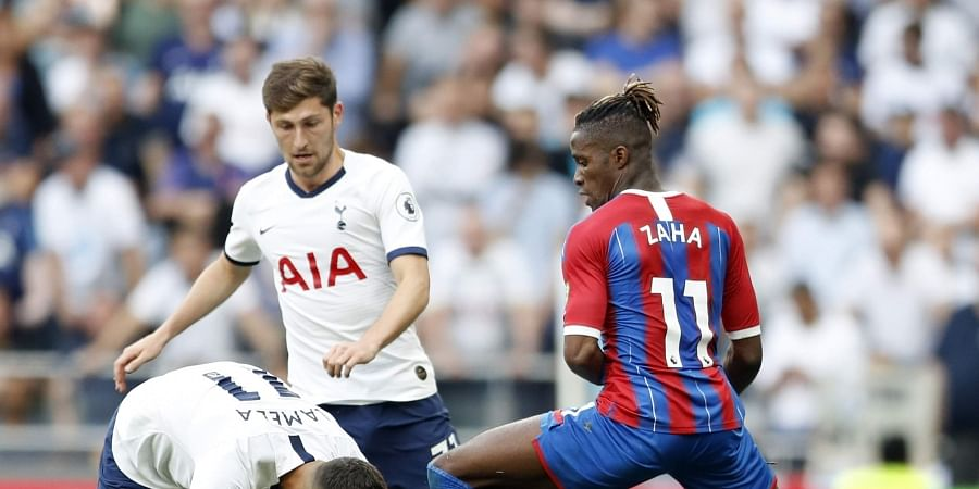 Tottenham's Erik Lamela, left, duels for the ball with Crystal Palace's Wilfried Zaha during their English Premier League soccer match between Tottenham Hotspur and Crystal Palace at White Hart Lane stadium in London, Saturday, Sept. 14, 2019. | AP