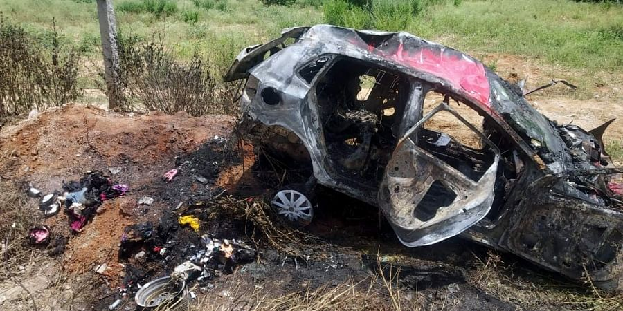 The remains of the car that went up in flames after overturning at Mamadugu in Gangavaram mandal of Chittoor district.
