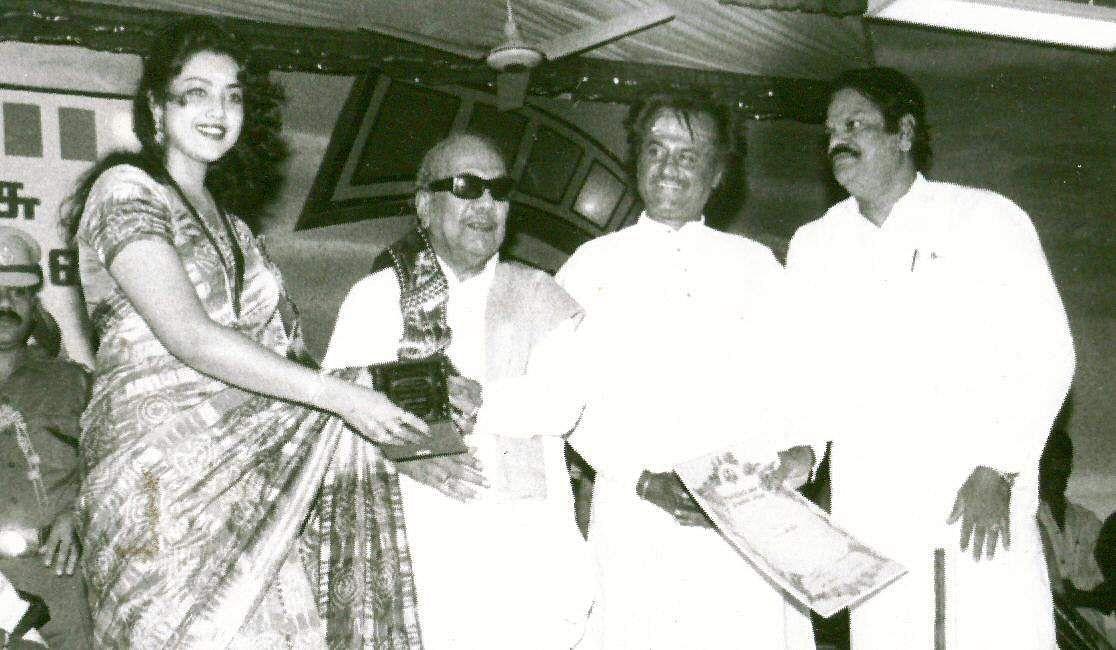 Then Tamil Nadu CM Karunanidhi presenting an award to actress Meena. Also seen is actor Rajinikanth.
