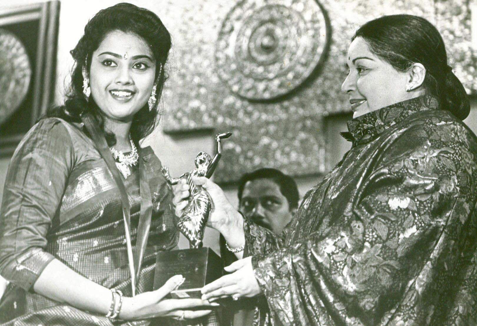 Tollywood actor A Nageswara Rao being honoured by actress Meena on his completion of golden jubilee in acting.