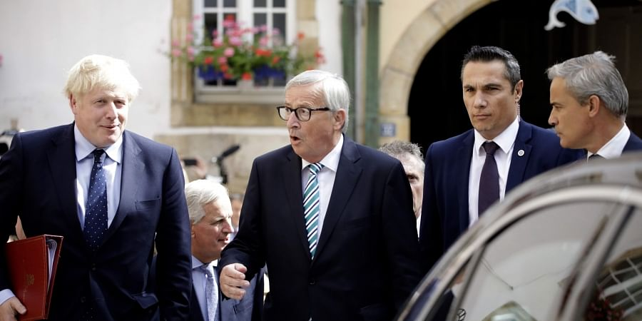 British Prime Minister Boris Johnson, left, and European Commission President Jean-Claude Juncker depart after a meeting in Luxembourg.
