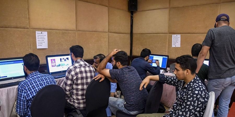 Journalists wait for their turn to access the internet at a temporary media centre set up by the government on the 42nd day following the abrogation of Article 370 in Srinagar Sunday September 15 2019. | PTI