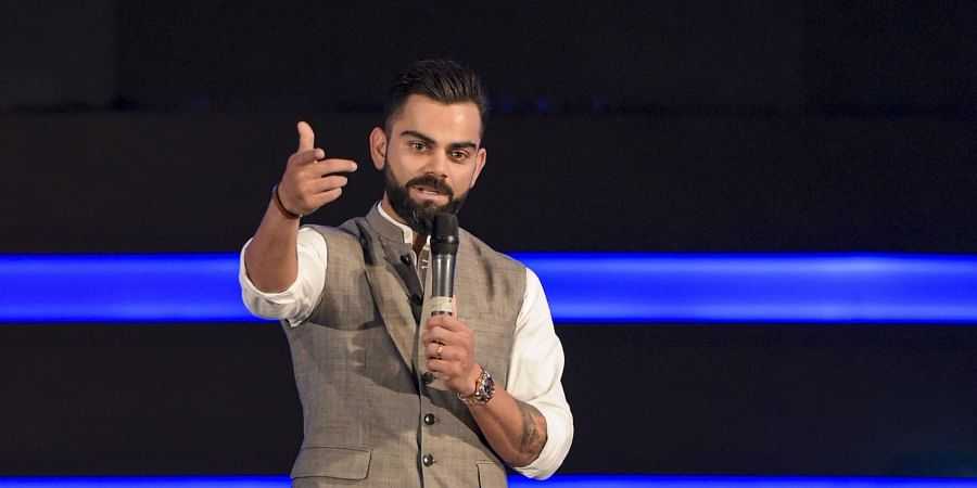 Indian cricket team Captain Virat Kohli addresses after the Delhi and District Cricket Association DDCA unveiled a new pavilion stand bearing his name. (Photo | PTI)