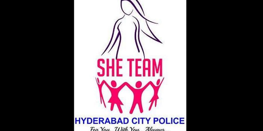 SHE team police logo