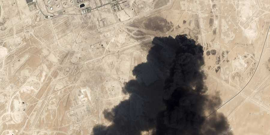 Satellite image provided by NASA Worldview shows fires following Yemen's Houthi rebels claiming a drone attack on two major oil installations in eastern Saudi Arabia.
