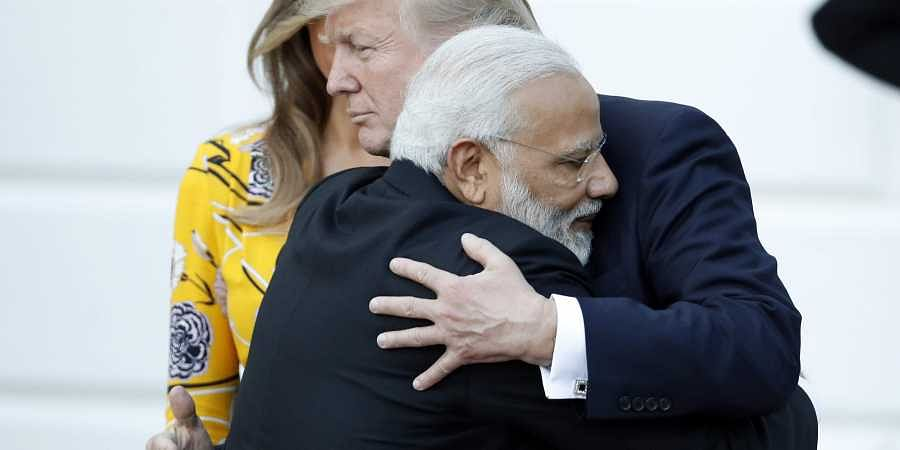 Prime minister Narendra Modi met US president Donald Trump for the first time after the latter took office. Trump extended his hand for a handshake but PM Modi pulled him into a bear hug. The Indian PM's embrace has become a signature move in greeting global leaders and celebrities alike. (AP)