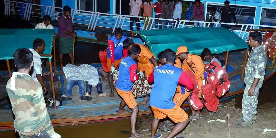 APSDRF personnel rescue passengers of a boat which capsized in the swollen Godavari river in East Godavari district of Andhra Pradesh