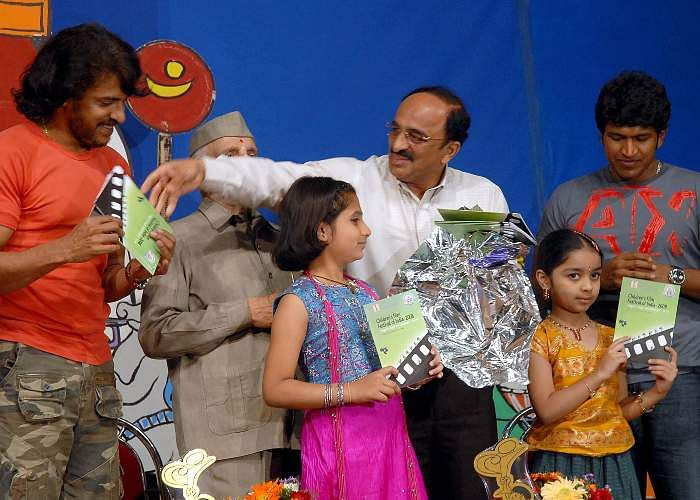 Actors Upendra and Puneeth Rajkumar with Information Department Director KVR Tagore and Karnataka Film Chamber of Commerce, KFCC President Thallam Nanjundashetty at the inauguration of Childrens Film Festival of India 2008 in Bangalore.