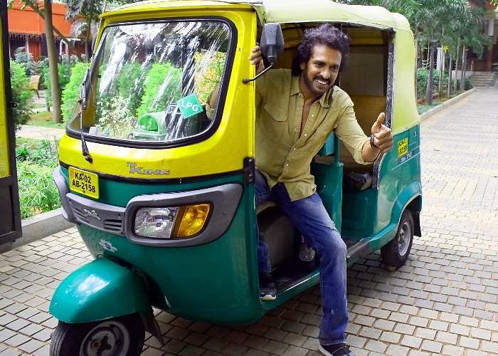 Upendra rides in an auto for a press meet near Bengaluru Press Club.