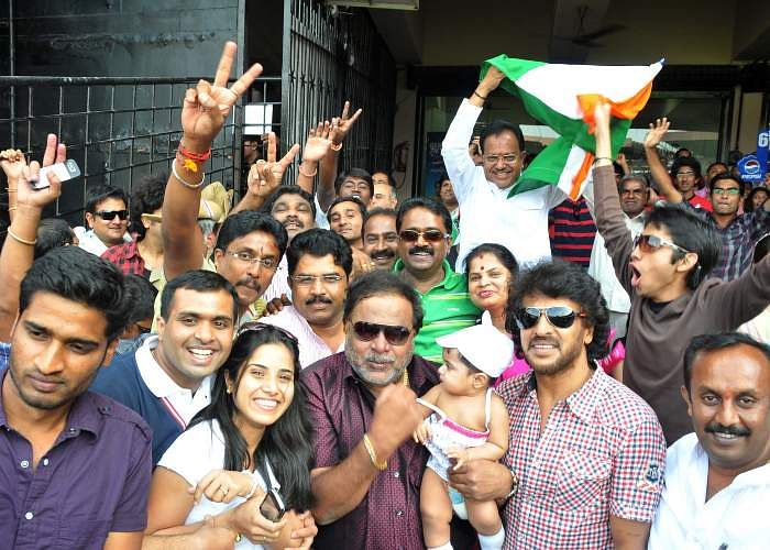 Kannada actors Upendra and Ambarish and others are seen during the World Cup Cricket match between India vs England at Chinnaswamy Stadium in Bangalore.