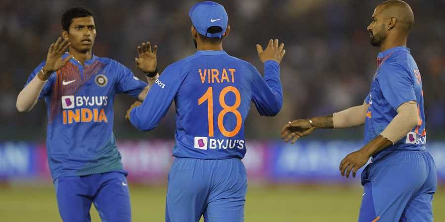 India players celebrate the dismissal of South Africa's captain Quinton de Kock during the second T20 international match between India and South Africa, in Mohali, India.