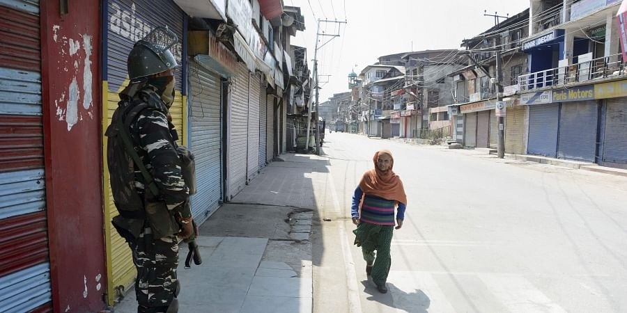 Security person stands guard at a closed market on the 44th day of strike after the abrogration of Article 370 and bifurcation of state in Srinagar Tuesday September 17 2019. | PTI