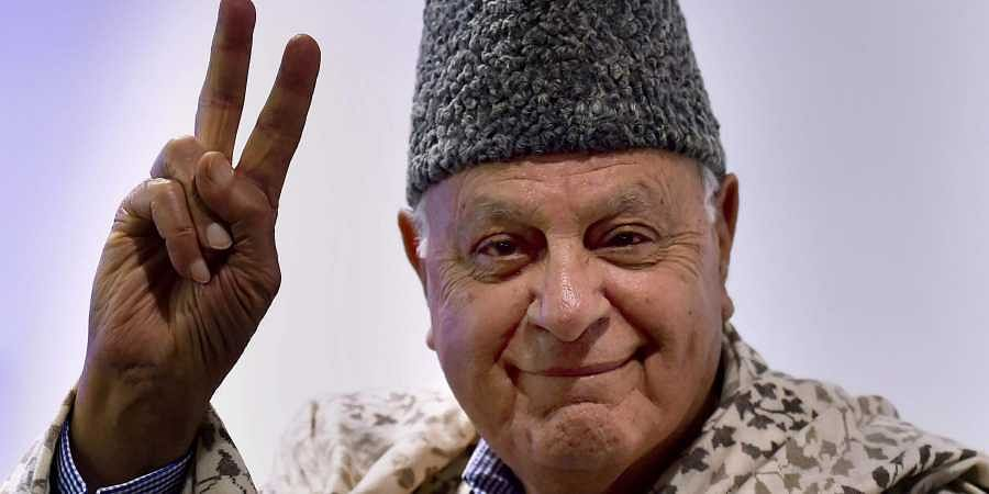 National Conference President Farooq Abdullah flashes victory sign on his arrival for an event at Bharat Chamber of Commerce in Kolkata. (Photo | PTI)