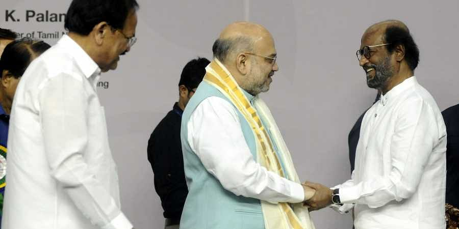 Union Home Minister Amit Shah (L) and actor Rajinikanth. | (File | EPS)
