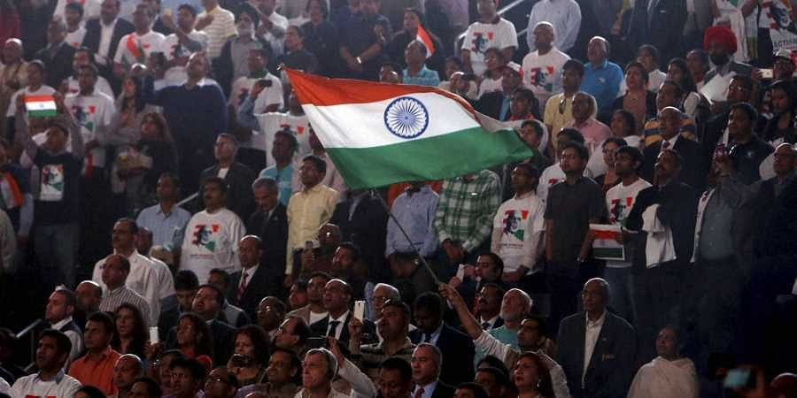 Supporters wave an Indian flag as Prime Minister Narendra Modi prepares to address during a reception organised in his honour by the Indian American Community Foundation at Madison Square Garden in New York.
